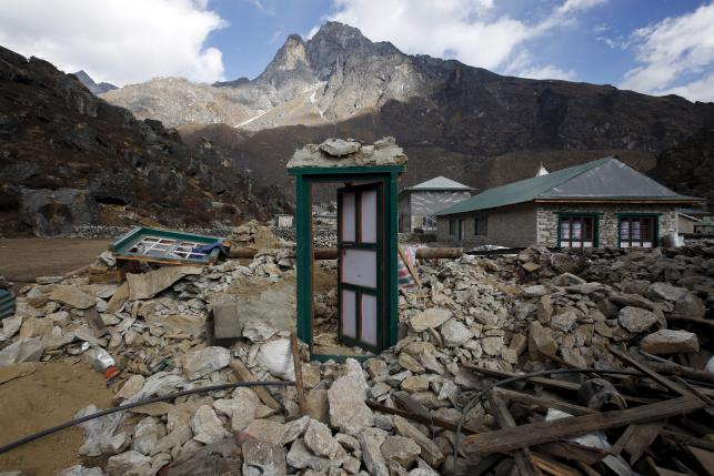 A door of a collapsed house stands after the earthquake damaged it earlier this year at Khumjung, a typical Sherpa village in Solukhumbu district also known as the Everest region, in this picture taken November 30, 2015. Photo: Reuters