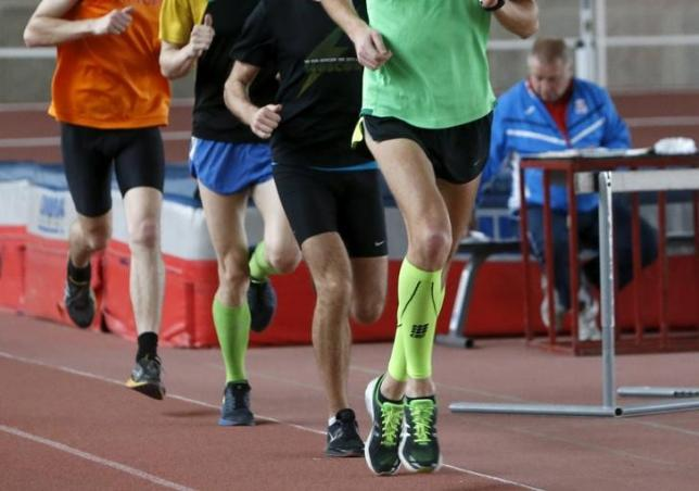 Sportsmen run during a training session at the Brothers Znamensky Olympic Centre in Moscow, Russia, November 10, 2015. Photo: REUTERS