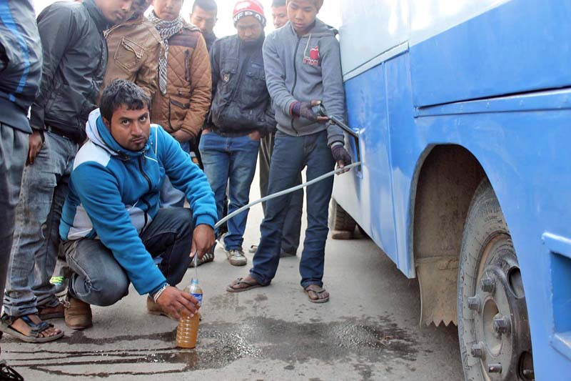 A sample of diesel being taken out from a bus as the vehicle did not run after refilling fuel from Sallaghari-based Suryabinayak petrol pump, in Bhaktapur, on Monday, December 28, 2015. Photo: RSS