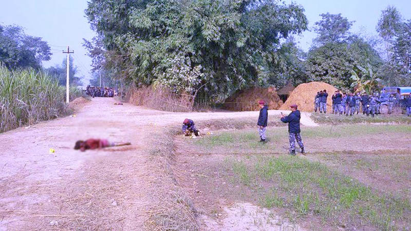 Police examining the site where two persons were found dead in Paltuwa VDC of Rautahat district, on Saturday, December 19, 2015. Photo: Prabhat Kumar Jha