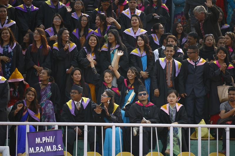 New graduates of Tribhuvan University share a happy moment at the 41st convocation ceremony in Kathmandu, on Wednesday, December 2, 2015. Photo: Skanda Gautam