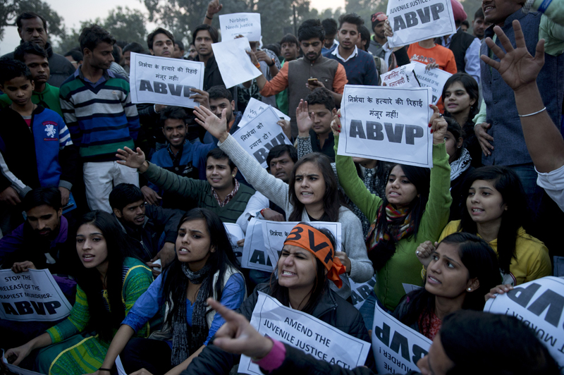 Members of Indian students organization ABVP shout slogans as they protest the release of a juvenile convicted in the fatal 2012 gang rape that shook the country in New Delhi, India, Sunday, Dec.20, 2015. The man, who was short of his 18th birthday at the time of the crime, was to finish his three-year term in a reform home on Sunday. Photo: AP