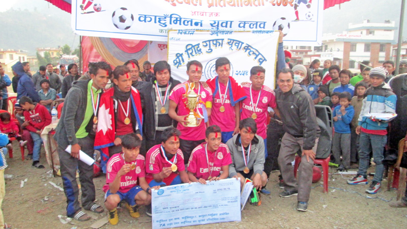Siddhagufa Yuva Club players and officials celebrate after winning the Districtwide Seven-a-side Football Tournament in Tanahun on Wednesday, December 30, 2015. Photo: THT