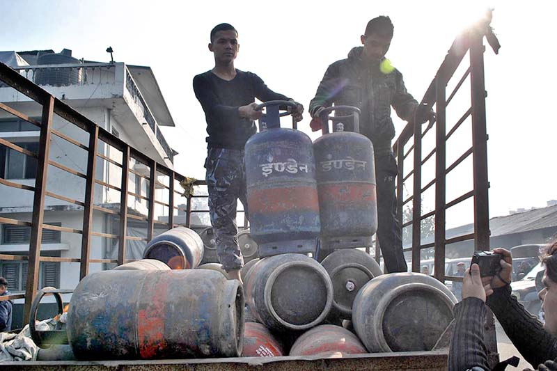 The tractor impounded by the District Police Office, Parsa, laden with 55 filled cooking gas cylinders illegally imported from India, in Mahadevpatti of Parsa district, on Tuesday, December 22, 2015. Photo: Ram Sarraf/ THT