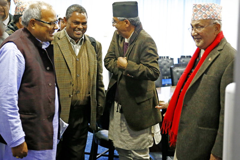 Prime Minister KP Sharma Oli is seen with senior leaders of the main opposition Nepali Congress and the agitating United Democratic Madhesi Front after the tripartite talks in Singha Durbar, Kathmandu, Nepal in December 2015. Photo: Skanda Gautam