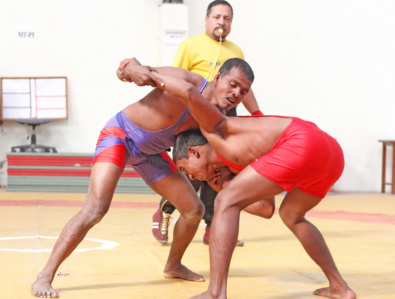 Jay Mangal Yadav (left) of Parsa fights against Lichan Mahato of TAC during their 57kg final of the selection tournament in Lalitpur on Tuesday. Photo: THT