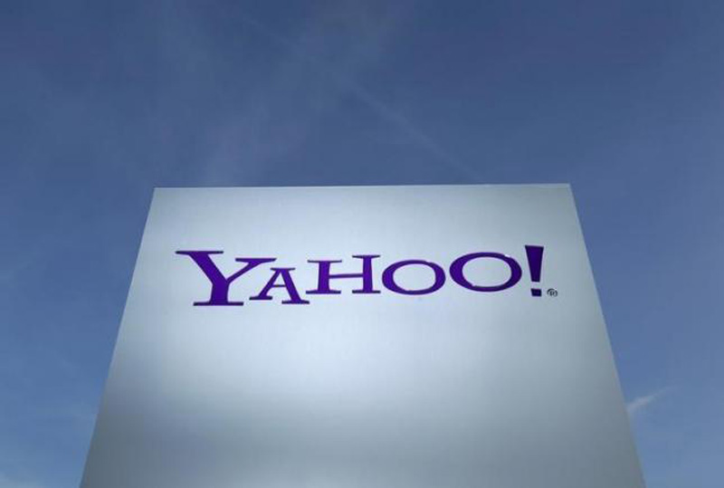 A Yahoo logo is pictured in front of a building in Rolle, 30 km (19 miles) east of Geneva, in this file picture taken December 12, 2012. Photo: Reuters