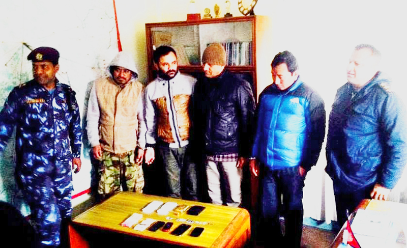 Police making a gang involved in selling fake gold public at District Police Office, Kavre, on Thursday, January 21, 2016. Photo: THT