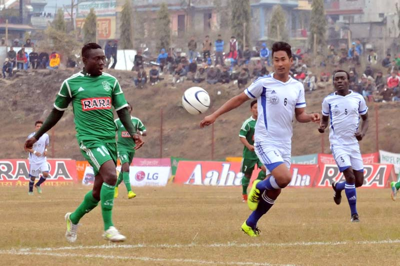 Players of Sahara Club and Navajagriti Youth Club vie for the ball during their match of the 14th Aaha-Rara Gold Club at the Pokhara Stadium on Tuesday, January 19, 2016.