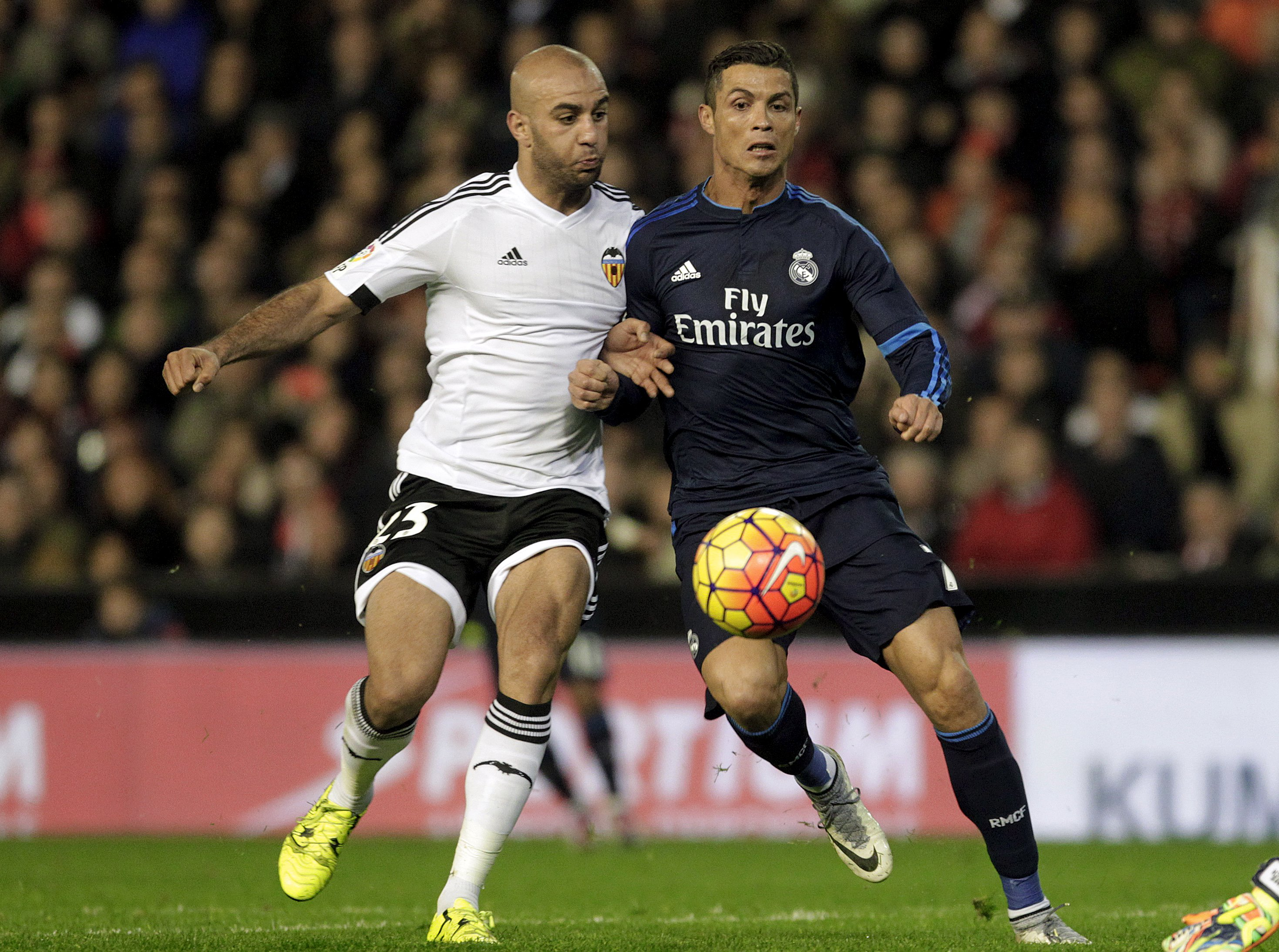 Real Madrid's Cristiano Ronaldo (R) and Valencia's Aymen Abdennour in action during La Liga game at Mestalla Stadium on Monday, January 3, 2016. Photo: Reuters