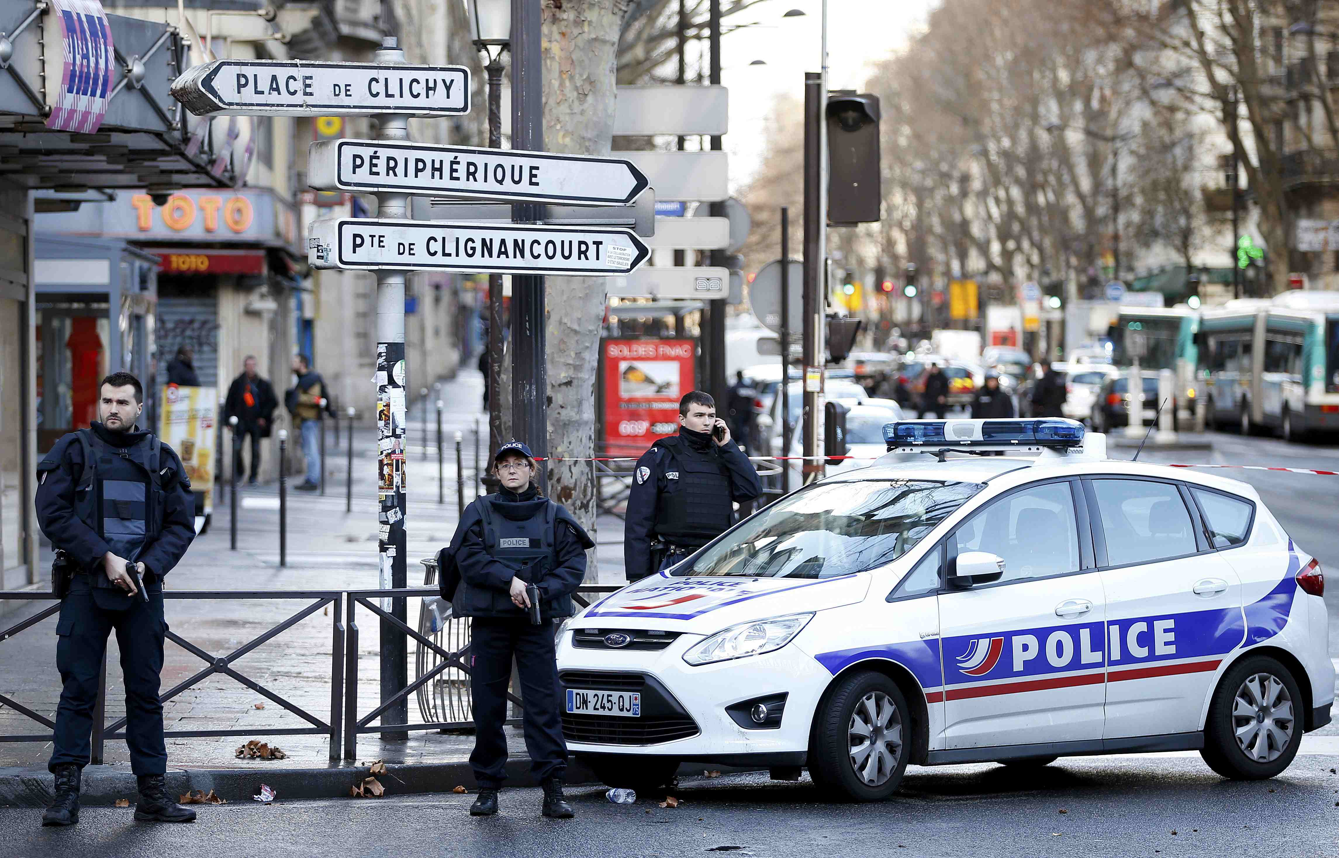 French police secure the area after a man was shot dead at a police station in the 18th district in Paris, France January 7, 2016. Photo: Reuters