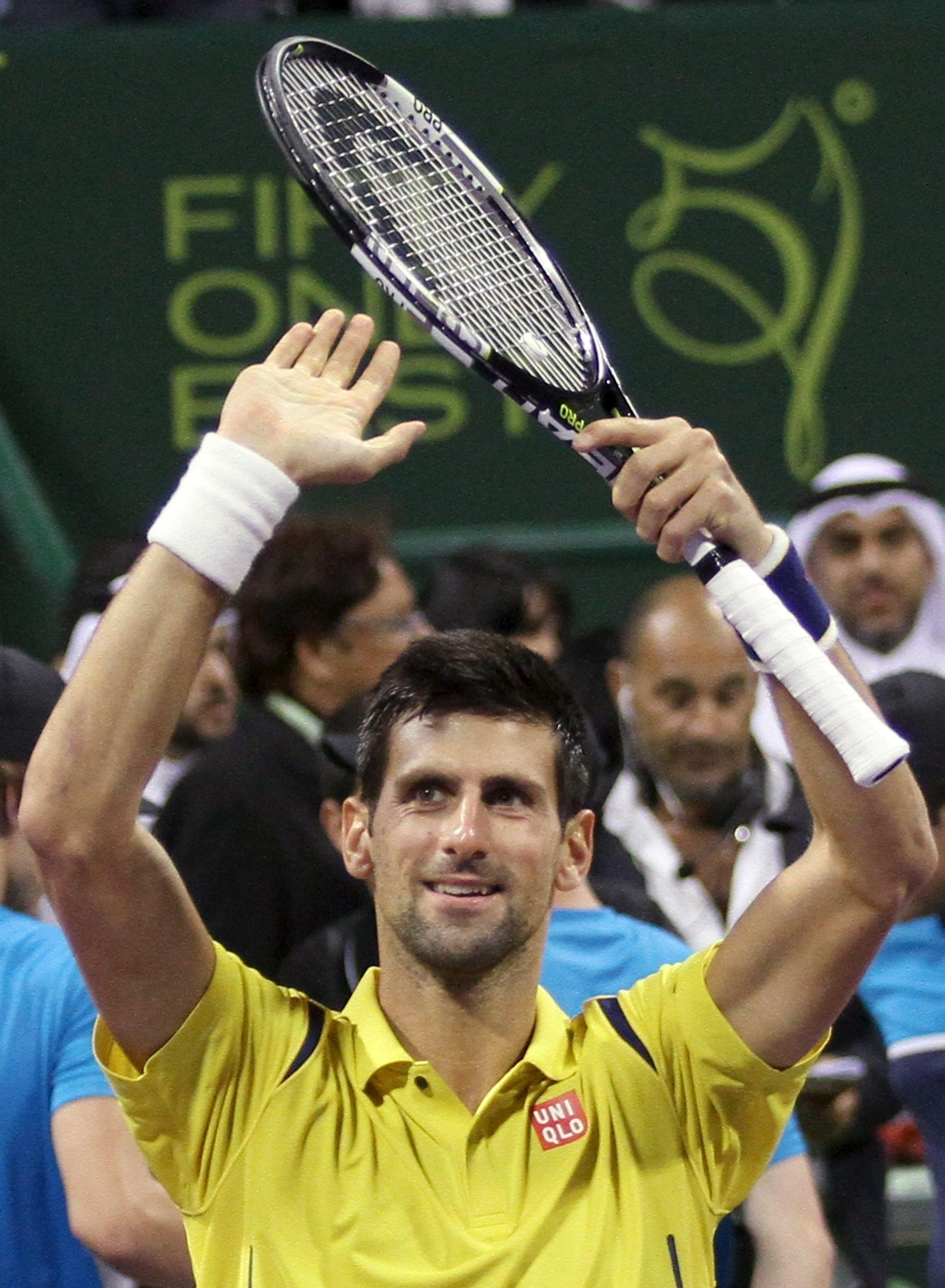 Novak Djokovic of Serbia celebrates after winning his Qatar Open men's single tennis final match against Rafael Nadal of Spain in Doha, Qatar, January 9, 2016. Photo: Reuters