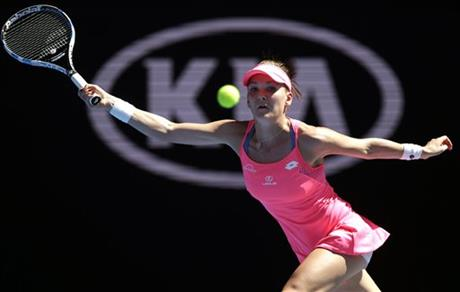 Agnieszka Radwanska of Poland makes a forehand return to Christina McHale of the United States during their first round match at the Australian Open tennis championships in Melbourne, Australia, Monday, Jan. 18, 2016. Photo: AP