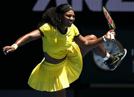 Serena Williams of the United States lifts her leg during their first round match against Camila Giorgi of Italy at the Australian Open tennis championships in Melbourne, Australia, Monday, Jan. 18, 2016. Photo: AP