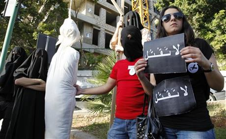 FILE - In this Thursday, April 1, 2010 file photo, activists from a civil organization reenact an execution scene in front of the Saudi Arabia Embassy in Beirut, Lebanon, as they protest a possible beheading of a Lebanese man accused of witchcraft in Saudi Arabia. Photo: AP