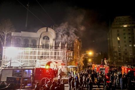 Smoke rises as Iranian protesters set fire to the Saudi embassy in Tehran, Sunday, Jan. 3, 2016. Protesters upset over the execution of a Shiite cleric in Saudi Arabia set fires to the Saudi embassy in Tehran. Photo: AP