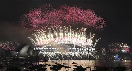 Fireworks explode over the Opera House and Harbour Bridge during New Year's Eve fireworks display in Sydney, Australian, Friday, Jan. 1, 2016. Photo: AP