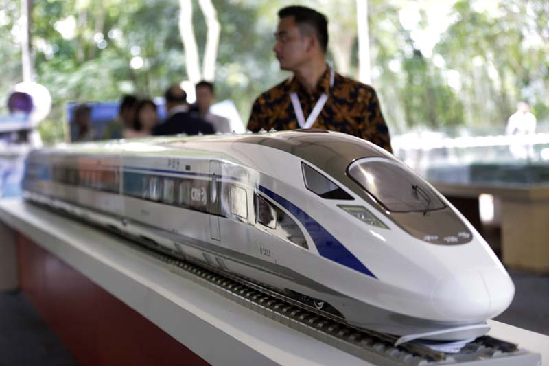 A visitor walks past a model of the high-speed rail line which will connect the capital city of Jakarta to the country's fourth largest city, Bandung, during the groundbreaking ceremony for the construction of its railway in Cikalong Wetan, West  Java, Indonesia, on Thursday, January 21, 2016. Photo: AP