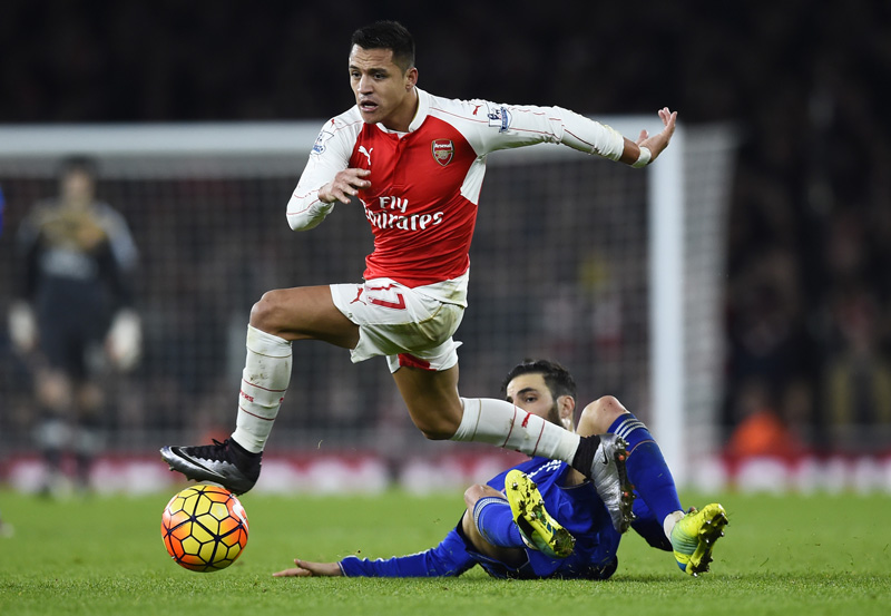 Arsenal's Alexis Sanchez in action with Chelsea's Cesc Fabregasnduring Barclays Premier League game at Emirates Stadium on Sunday, January 24, 2016. Photo: Reuters