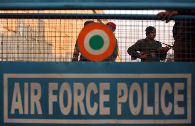 An Indian security personnel stands guard next to a barricade outside the Indian Air Force (IAF) base at Pathankot in Punjab, India, January 2, 2016.  REUTERS/Mukesh Gupta