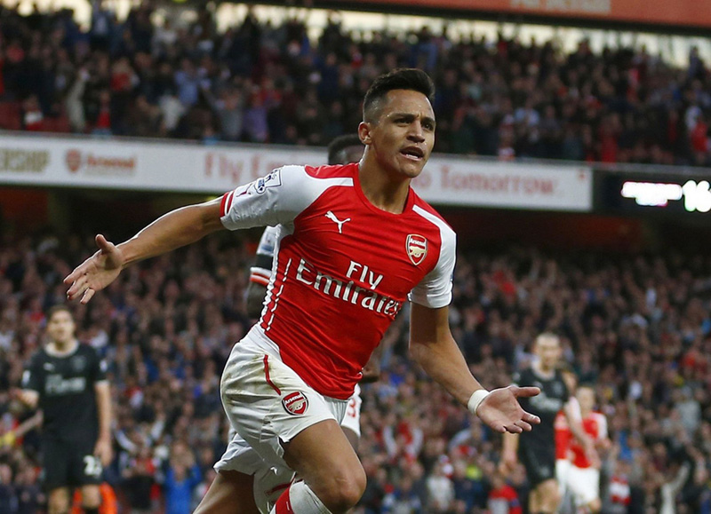 File photo of Arsenal striker Alexis Sanchez celebrates after scoring goal.