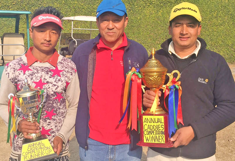 Annual Caddies Competition winner Amit Bogati (right) and runner-up Bharat Thapa Magar with senior member of Gokarna Golf Club Tendi Sherpa (centre) in Kathmandu on Wednesday. Photo Courtesy: Gokarna Golf Club