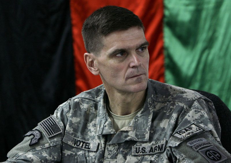 FILE - Then- US Brig. Gen. Joseph Votel listens in front of an Afghan national flag during a meeting with Afghan officials in an Afghan military base in Kabul, Afghanistan on February 24, 2007. Photo: AP