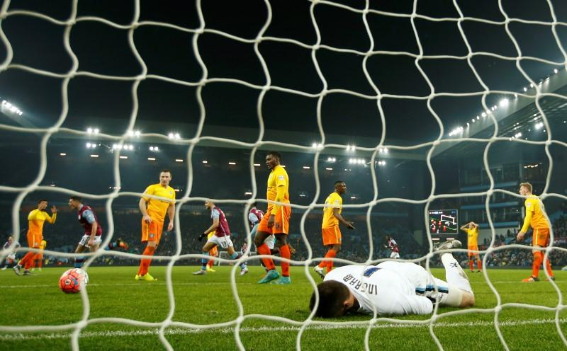 Football Soccer - Aston Villa v Wycombe Wanderers - FA Cup Third Round Replay - Villa Park - 19/1/16nCiaran Clark celebrates scoring the first goal for Aston Villa as Wycombe Wanderers' Matt Ingram looks dejectednAction Images via Reuters / John SibleynLivepic
