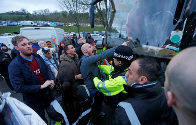 Aston Villa fans gesture towards the team coach after the game. Reuters / Eddie Keoghn