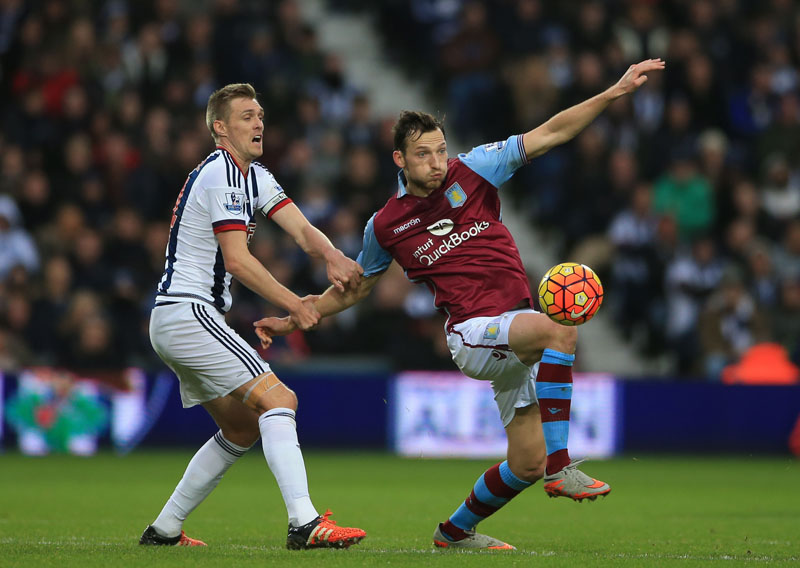 Aston Villa's Libor Kozak (right) is held by West Bromwich's Albion's Darren Fletcher during their English Premier League soccer match at The Hawthorns, West Bromwich, England, on Saturday, January 23, 2016. Photo: AP