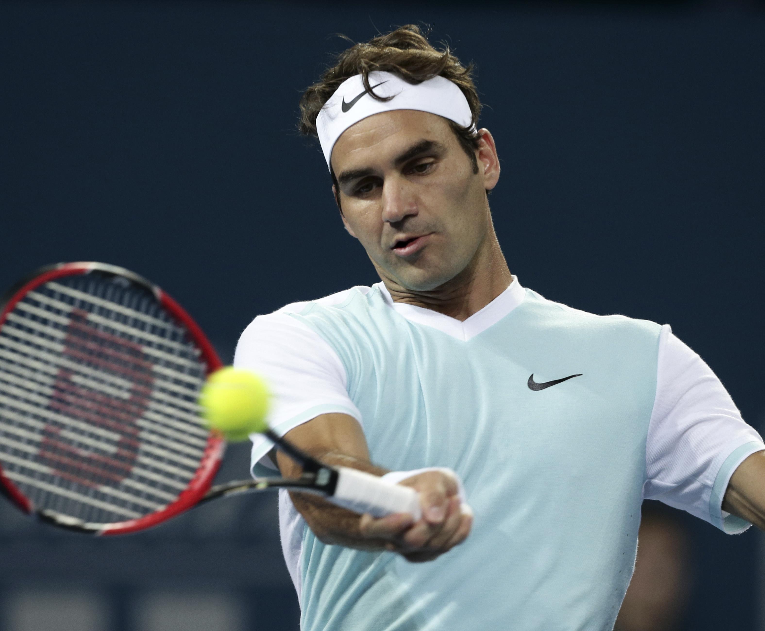 Roger Federer of Switzerland plays a shot in his quarterfinal game against Grigor Dimitrov of Bulgaria during the Brisbane International tennis tournament in Brisbane, Australia, Friday, January 8, 2016. Photo: AP