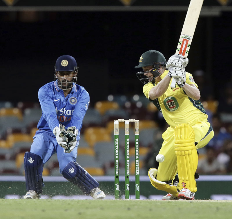 Australia's George Bailey (right) plays a shot as India's wicketkeeper Mahendra Singh Dhoni looks on during their second One Day International match in Brisbane on Friday. Photo: AP