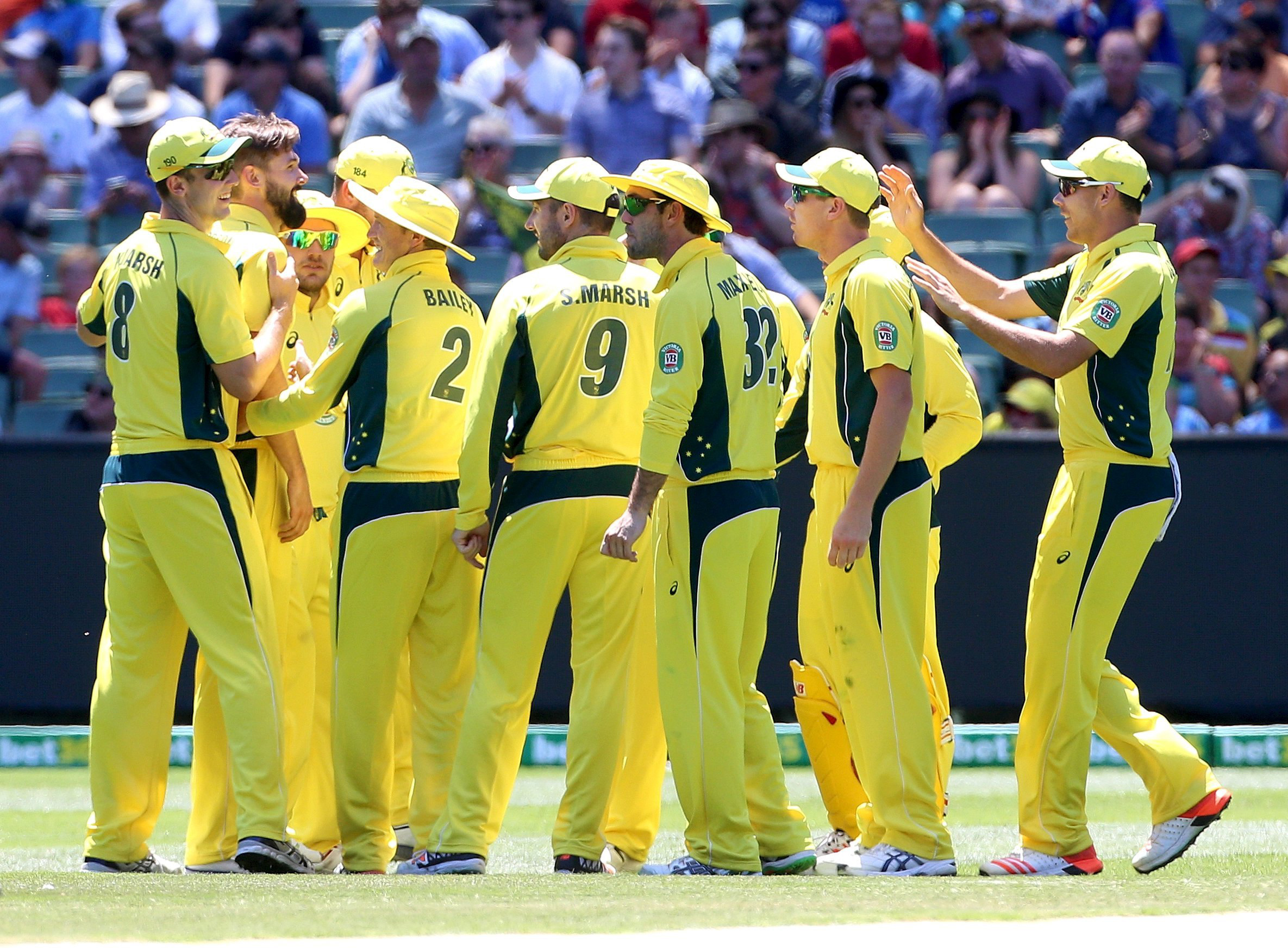 Australia's Kane Richardson (2nd L) is congratulated by team mates after taking the wicket of India's Rohit Sharma during their One Day cricket match at the Melbourne Cricket Ground January 17, 2016. Photo: Reuters