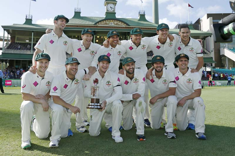 Australia's test cricket captain Steve Smith holds the Frank Worrell trophy among team mates after their third cricket test against the West Indies at the Sydney Cricket Ground (SCG) in Sydney, on January 7, 2016. Photo: Reuters