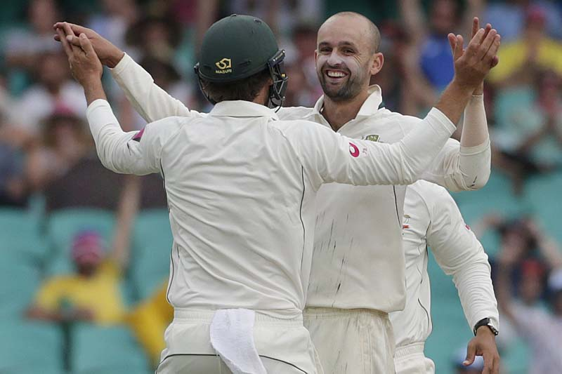 Australia's spinner Nathan Lyon (right) celebrates his 100th test wicket on Australian soil after captain Steve Smith caught out West Indies batsman Kraigg Brathwaite during their third cricket test at the Sydney Cricket Ground (SCG) in Sydney, January 3, 2016. Photo: Reuters