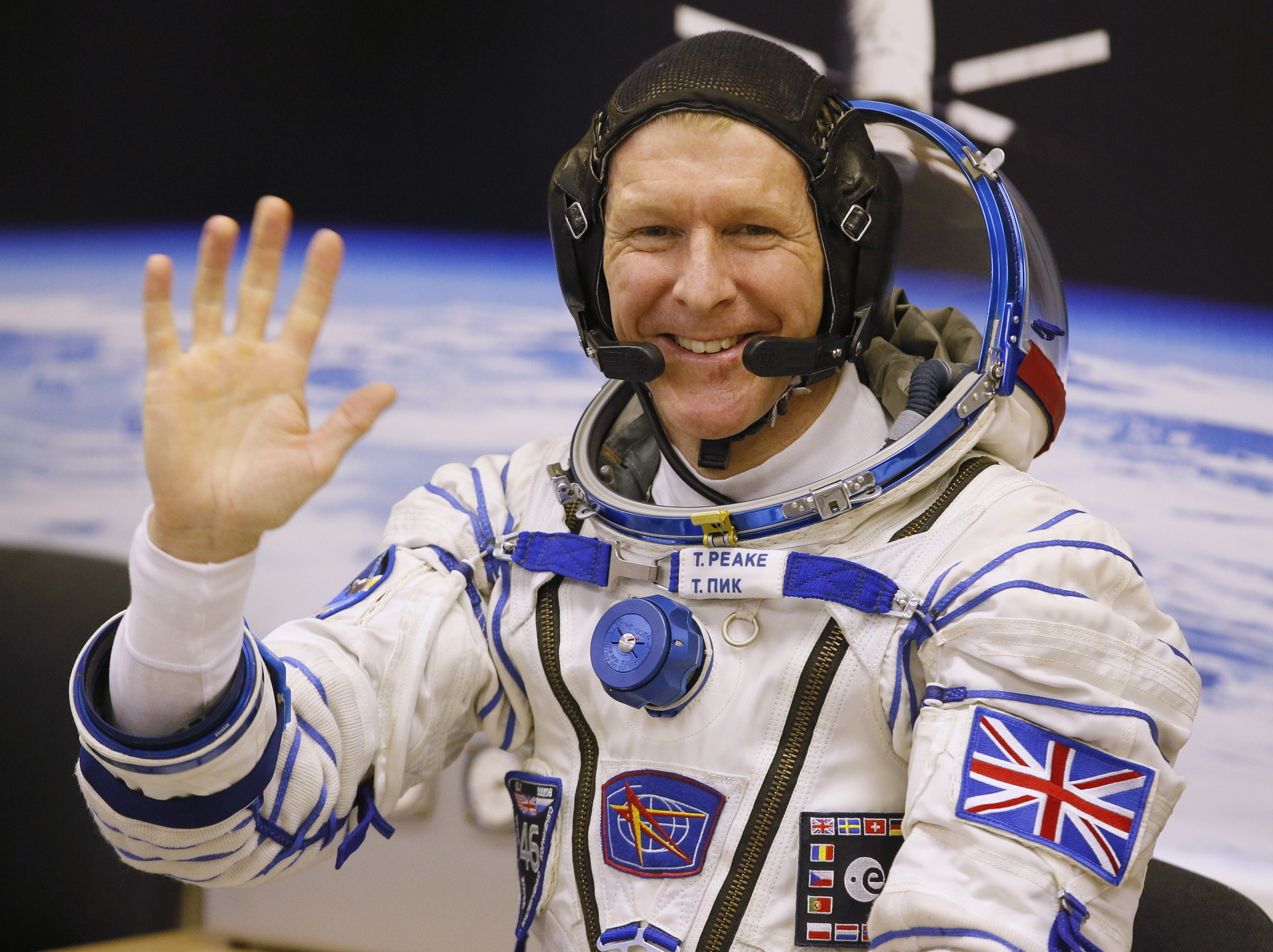 FILE - In this Tuesday, December 15, 2015 file photo, British astronaut Tim Peake, member of the main crew of the expedition to the International Space Station (ISS), prior the launch of Soyuz TMA-19M space ship at the Russian leased Baikonur cosmodrome, Kazakhstan.