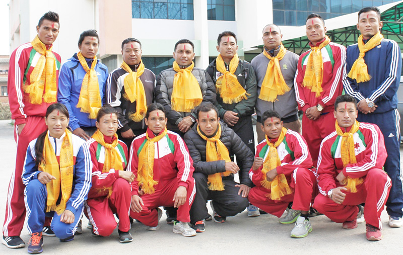 National boxing players pose for photo before their departure.