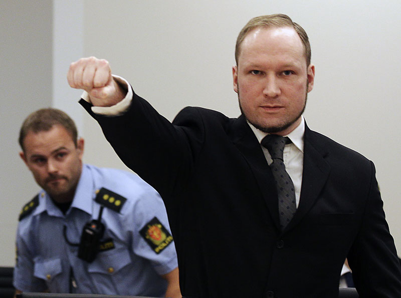 FILE -  Mass murderer Anders Behring Breivik makes a salute after arriving in the court room at a courthouse in Oslo on Friday, August 24, 2012. Photo: AP
