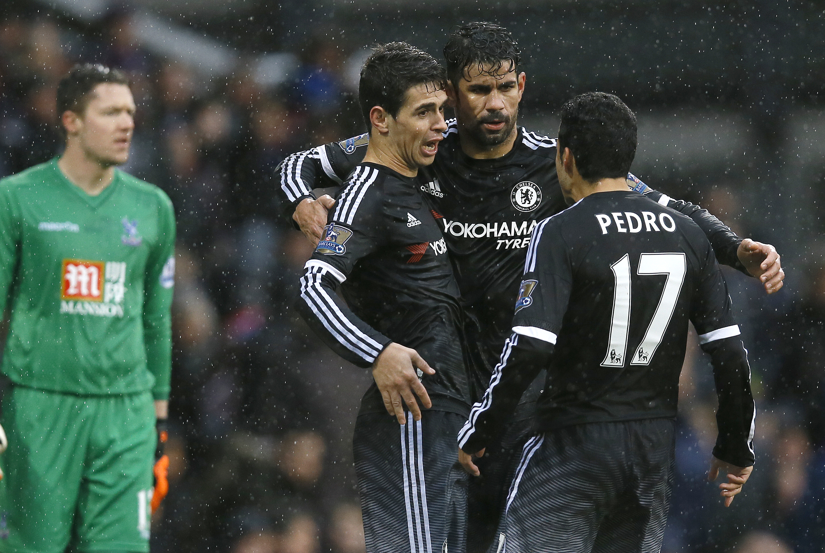 Chelsea's Oscar, front left, hugs Diego Costa, centre, and, Pedro, right, as he celebrates scoring a goal during the English Premier League soccer match between Crystal Palace and Chelsea at Selhurst Park stadium in London, Sunday, January 3, 2016. Photo: AP
