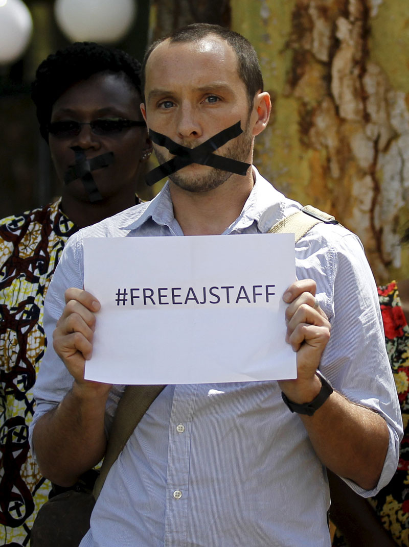 British photojournalist Phil Moore demonstrates against the imprisonment of three Al Jazeera journalists in Egypt, at the United Nations Environment Programme's (UNEP) headquarters in Nairobi, in this picture taken January 13, 2015. Burundi police have arrested Moore and a French journalist during a sweep for rebels in flashpoint districts of the capital, officials said on January 29, 2016, a move likely to further strain tense relations between Bujumbura and Western donors. Photo taken on January 13, 2015. Photo: Reuters