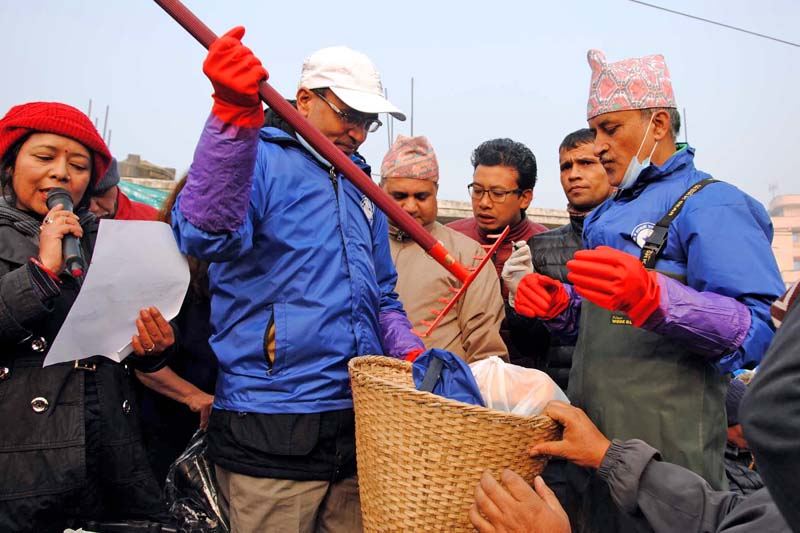 FILE: Nepal Telecom (NT) Managing Director Buddhi Prasad Acharya handing over the cleaning equipments to the leader of the clean-up campaign, former Chief Secretary Leela Mani Paudyal, in Kathmandu, on Saturday, January 30, 2016. Photo:  Nepal Telecom