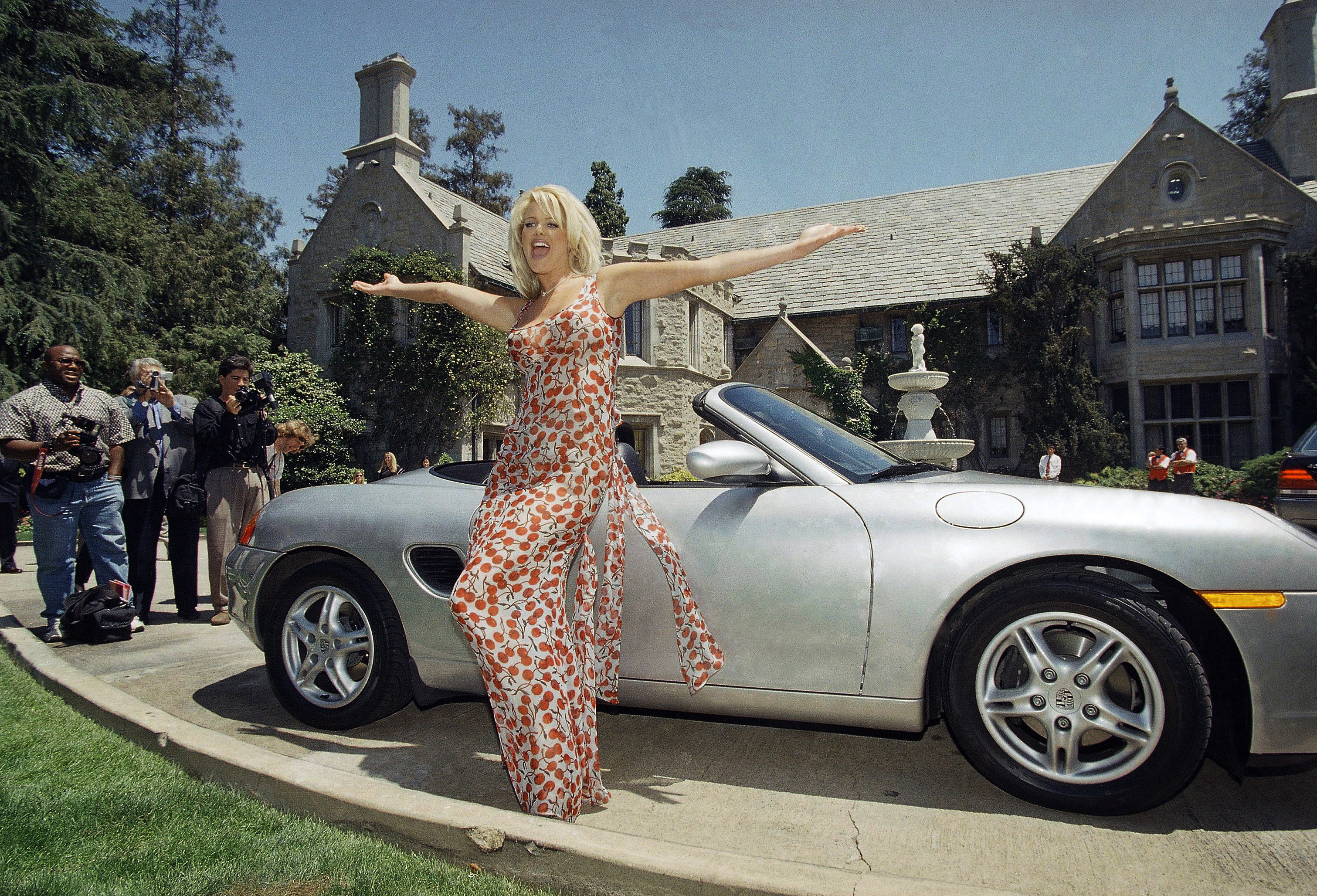 File photo of Victoria Silvstedt poses with her brand new Porsche in front of the Playboy Mansion in Beverly Hills, California on Monday, January 11, 2016. Photo: AP