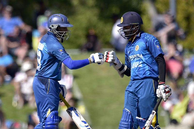 Sri Lanka's Tillakaratne Dilshan (left) celebrates after hitting a boundary with Lahiru Thirimanne during their third ODI match against New Zealand in Nelson on Thursday. Photo: AFP