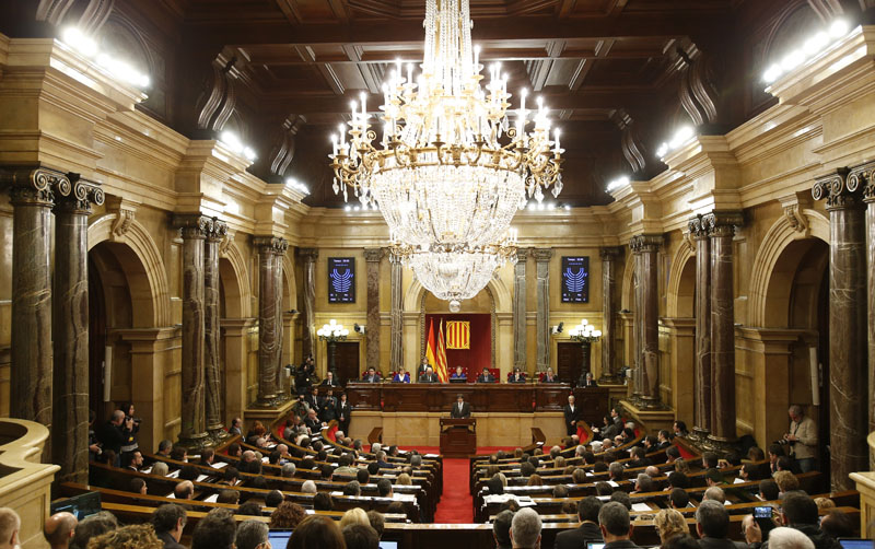 Incoming Catalan President Carles Puigdemont speaks during the investiture session at the Catalonian parliament in Barcelona, Spain, on Sunday, January 10, 2016. Photo: AP