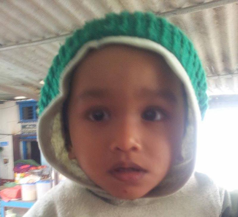 A one-and-a-half-year-old child who is in prison as his parents were sent to Kaski Jail for human trafficking, in Pokhara, on Wednesday.  Photo: THT