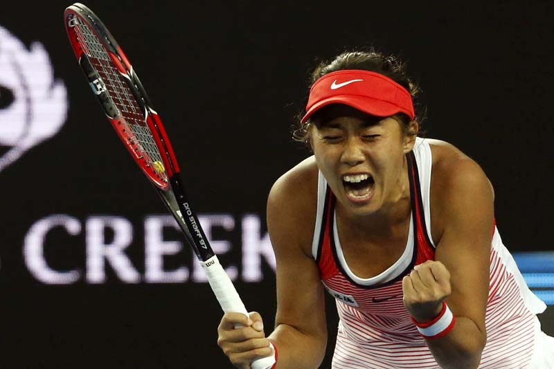 China's Zhang Shuai celebrates after winning her first round match against Romania's Simona Halep at the Australian Open tennis tournament at Melbourne Park, Australia, on January 19, 2016. Photo: Reuters