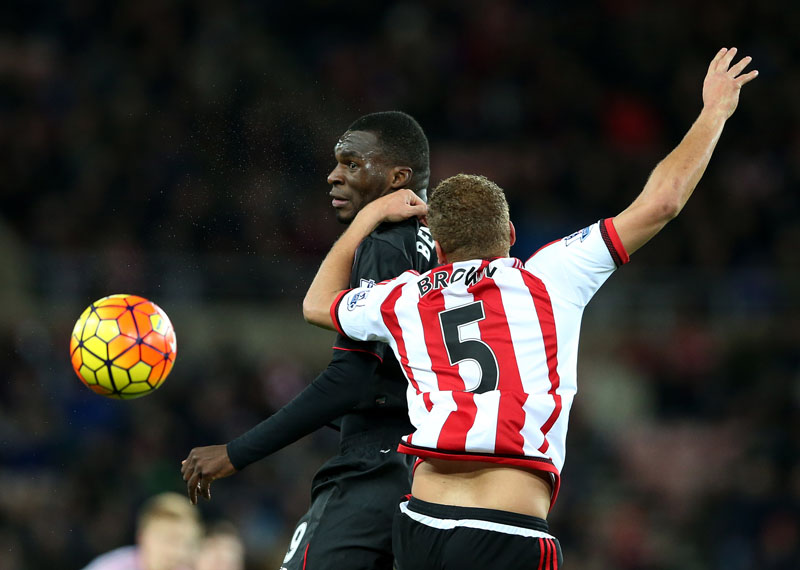Liverpool's Christian Benteke (left) vies for the ball with Sunderland's Wes Brown during their English Premier League match at the Stadium of Light in Sunderland on Wednesday. Photo: AP