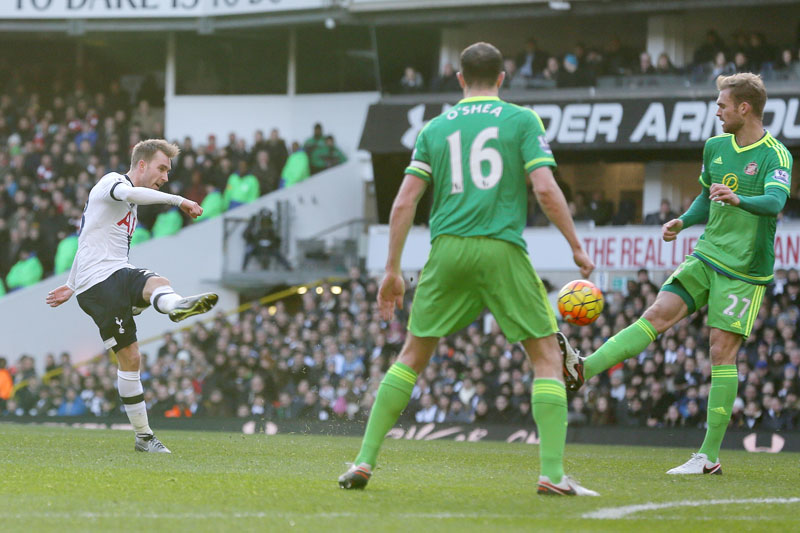 Tottenham Hotspur's Christian Eriksen (left) shoots the ball to score past Sunderland players during their English Premier League match at the White Hart Lane in London on Saturday. Photo: AP