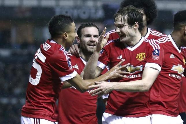 Football Soccer - Derby County v Manchester United - FA Cup Fourth Round - iPro Stadium - 29/1/16. Daley Blind celebrates with team mates after scoring the second goal for Manchester United Reuters / Eddie Keogh Livepic