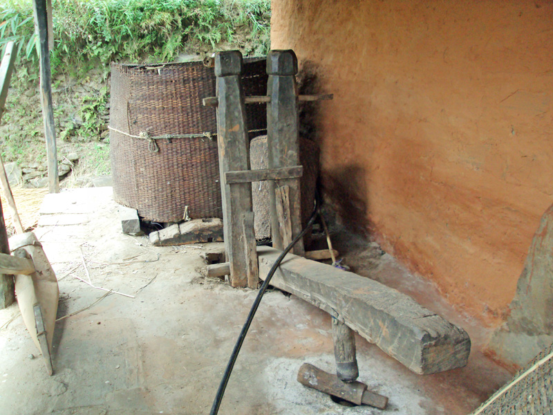 <i>Dhiki</i>, traditional grinder, left unused in porch of a house in Jogimara of Dhading district. Modern technology is gradually replacing traditional ones on Friday, January 15, 2016 Photo: Keshav Adhikari